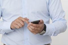 Touching a Smart Phone Stock Photo