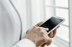 Touching smart phone Royalty Free Stock Photos