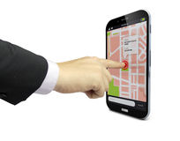 Touching a smartphone with location app on the screen Royalty Free Stock Photo