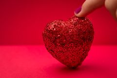 Touching a Sparkling Heart Stock Photos