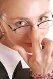 Touching Spectacles. And nose royalty free stock image