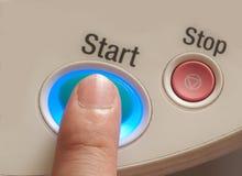 Touching start button. Turn on mode Royalty Free Stock Photos