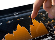 Touching Stock Market Chart. Touching stock market graph on a touch screen device Stock Images