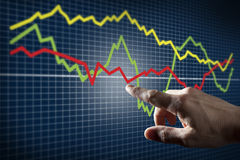 Touching Stock Market Chart Royalty Free Stock Photo