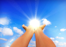 Touching the sun. Hands touching the sun, background Stock Photos