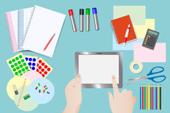 Touching tablet over equipment for education Royalty Free Stock Image