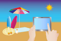 Touching tablet at summer beach. Beach umbrella, towel, straw hat, glasses and surfboards are located on the beach. The hand touching the empty tablet screen Royalty Free Stock Photos