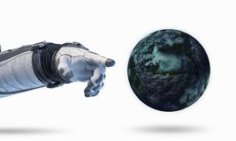 Touching the uniqueness. Mixed media. Close of astronaut robotic hand touching planet. Elements of this image furnished by NASA Stock Images