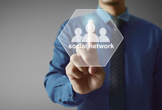 Touching virtual icon of social network. Male touching virtual icon of social network Royalty Free Stock Image