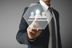 Touching virtual icon of social network Royalty Free Stock Photo