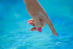Touching water. The hand of woman is touching water Stock Photography