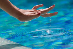 Touching water. The hand of woman is touching water Royalty Free Stock Image