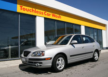 Touchless Car Wash 2. A nice clean car beside the car wash Royalty Free Stock Images