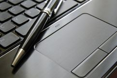 Touchpad et stylo Photographie stock