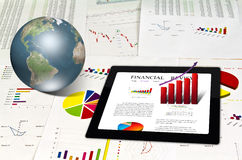 Touchpad on financial Graphs Royalty Free Stock Image