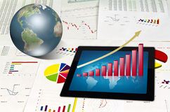 Touchpad on financial Graphs Royalty Free Stock Photos