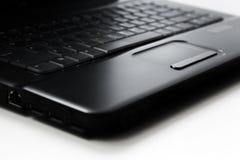 Touchpad nero del computer portatile su fondo bianco immagine stock