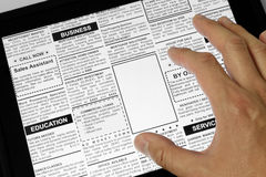 Touchpad and newspaper Royalty Free Stock Photography