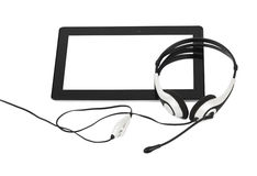 Touchpad pc and headphones Royalty Free Stock Image