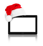 Touchpad pc and Santa Claus red christmas hat Stock Photos