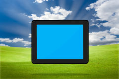 Touchpad PC (Tablet PC). Modern Touchpad PC (Tablet PC) on the green grass field Stock Images