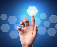 Touchscreen button. Hand pressing a touchscreen button Royalty Free Stock Photos