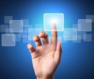 Touchscreen button. Hand pressing a touchscreen button Stock Photo