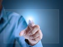 Touchscreen button. Business man pressing a touchscreen button Stock Photos