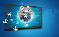 Touchscreen display and Globe with buildings on Stock Photography