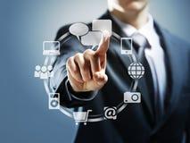 Touchscreen interface. Business man pressing virtual icons Stock Photos