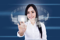 Touchscreen interface. Businesswoman is pressing virtual icons on blue background Stock Photos