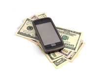 Touchscreen mobile phone and dollars Stock Image