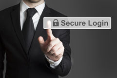 Touchscreen secure login. Businessman in suite pressing touchscreen secure login stock image