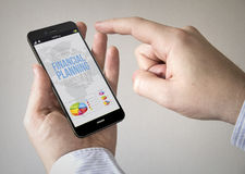 Touchscreen smartphone with financial planning on the screen Royalty Free Stock Image