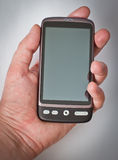 Touchscreen smartphone in hand Stock Photo
