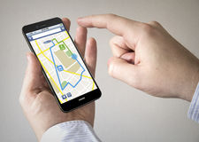 Touchscreen smartphone with online navigaation application on t Stock Image