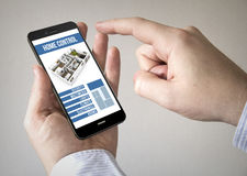 Touchscreen smartphone with smart home control app on the scree Stock Photography