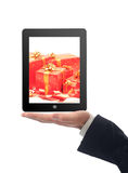 Touchscreen tablet with gift inside Royalty Free Stock Images