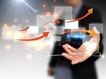 Touchscreen van de zakenmanholding Stock Afbeeldingen