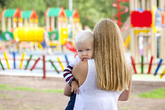 Touchy little boy in the arms of his mother Stock Photo