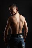 Tough asian guy. Great looking asian guy shot in studio - back pose royalty free stock image