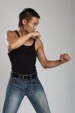 Tough asian guy. Great looking asian guy shot in studio - martial arts pose stock photos