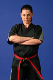 Tough Beauty. Beautiful Tough Woman in Karate Uniform with Serious Expression Royalty Free Stock Photography