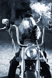 Tough Biker Woman on her Motorcycle Stock Photography