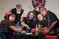 Tough Biker Gang with Weapons. Tough group of Caucasian biker gang members with weapons stock photo