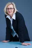 Tough businesswoman. Tough business woman in her office Royalty Free Stock Images
