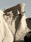 Tough Climb. Ancient geologic rock formation in the desert badlands of New Mexico stock photography