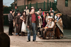 Tough Cowboy. With group of people in old west costumes Stock Photo