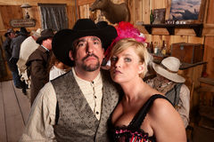 Tough Cowboy and Showgirl in Saloon Stock Photography