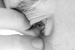 Tough decision. Close up of a face with drammaric effect, soft focus Stock Photo